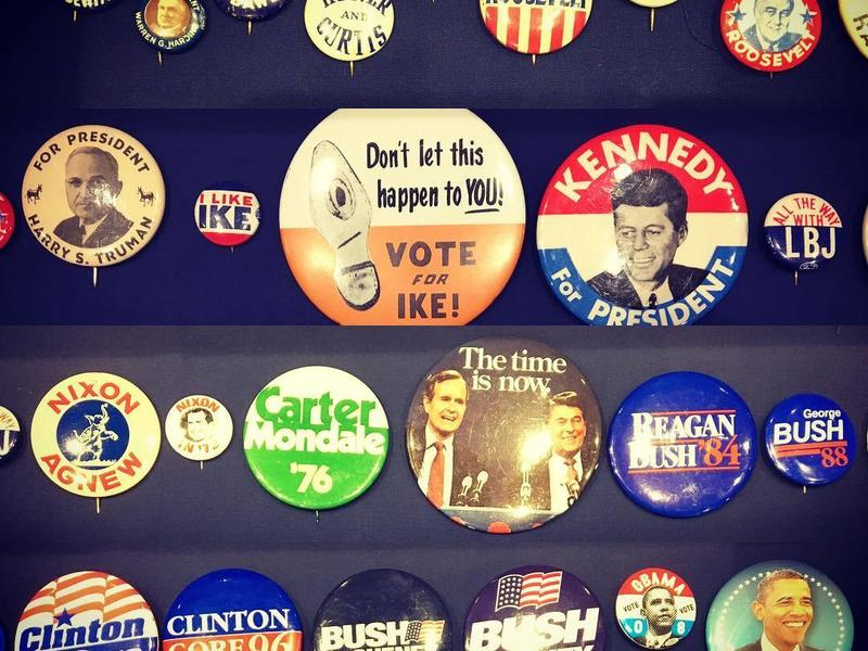 a collection of US election badges through the years