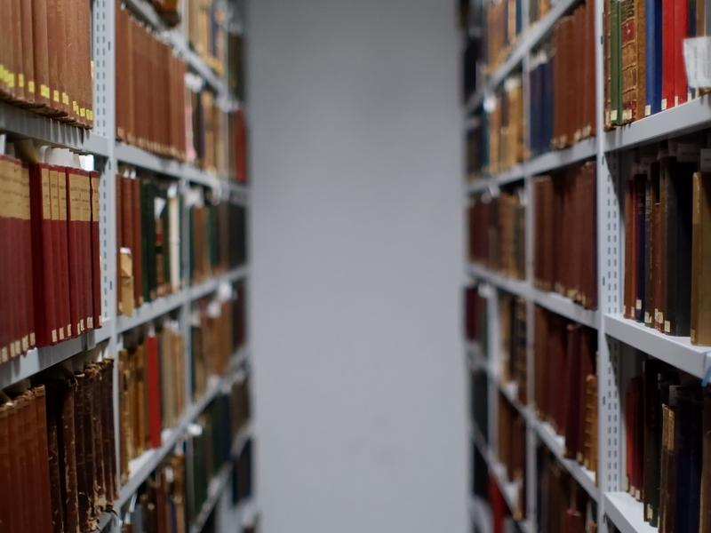 an isle of books in the library